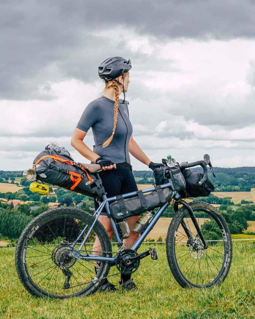 Jule and her bike in bikepacking mode