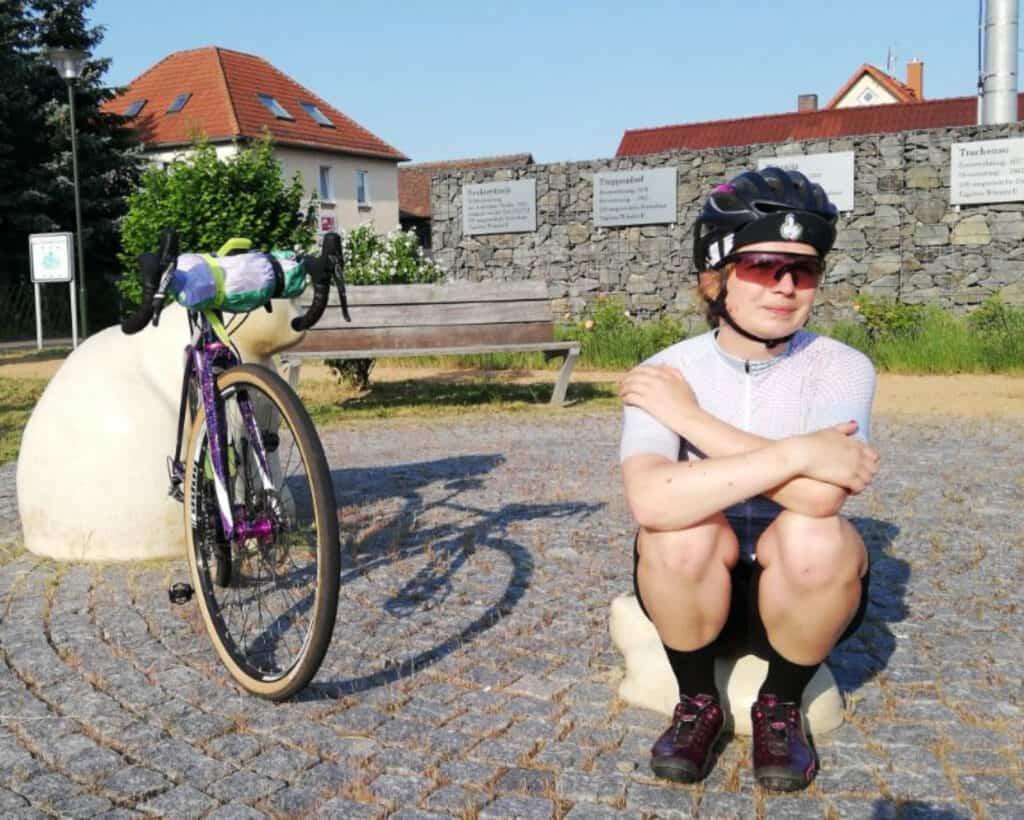 Sandra sitting next to her bike