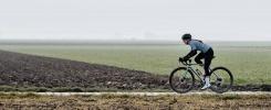 Wiebke Lühmann on her bike outside from the side